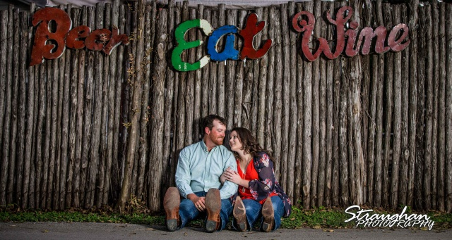 Heather and Wes's engagement session Gruene TX on the fence
