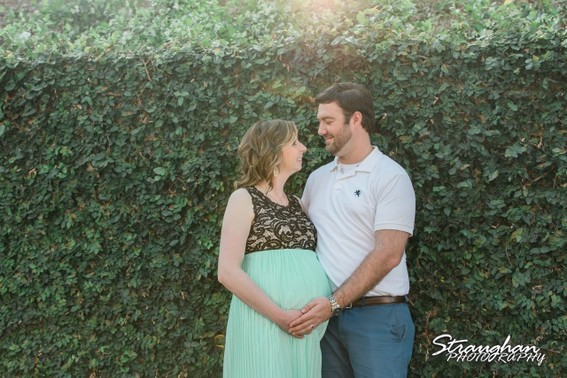 Kirstin's maternity by the green wall