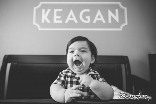 Keagan's three month shoot laughing in crib