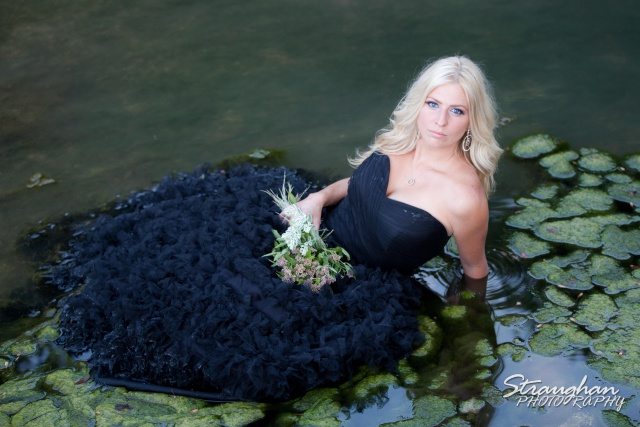 Tiff in the river with her dress