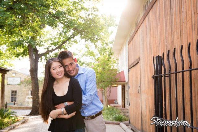 John and Christine's engagement sitting, San Antonio Riverwalk ,La Villita. Standing in front of studio John and Christine's engagement sitting, San Antonio Riverwalk ,La Villita. arms wrapped around each other