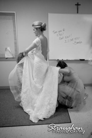 Emily and Brandon's Wedding, Annunciation Catholic Church, getting help getting dressed
