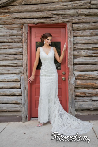 Clarissa's Bridal Sitting, Landa Library leaning on door