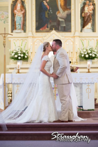 Emily and Brandon's Wedding, Annunciation Catholic Church first kiss as husband and wife