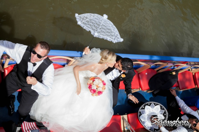 Michelle and Juan's,San Fernando Cathedral just married boat  bride and groom