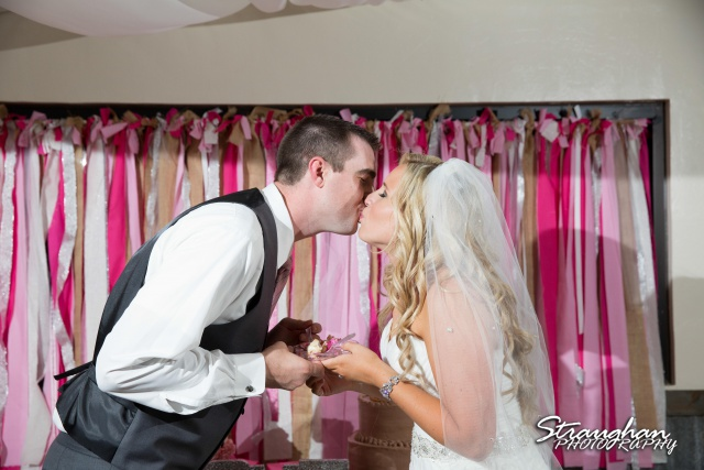 Eric and robyns wedding, a cake kiss