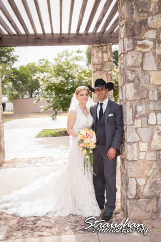 Wills wedding San Antonio, Country gold bride and groom standing together outside