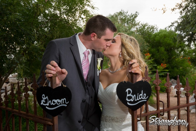 Eric and robyns wedding, kissing infront of gate