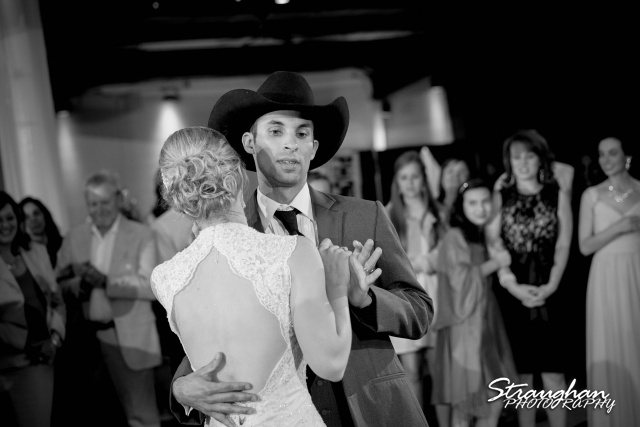 Wills wedding San Antonio, Country gold grooms face while dancing