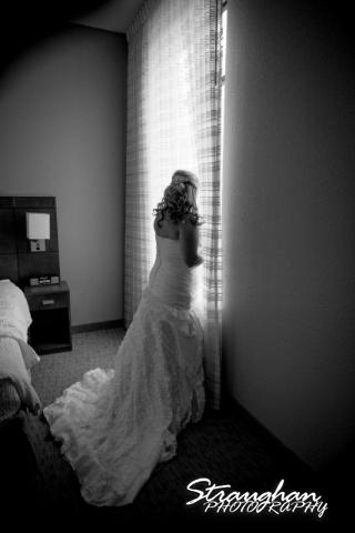 Angie wedding Marriott New Braunfels brides in window
