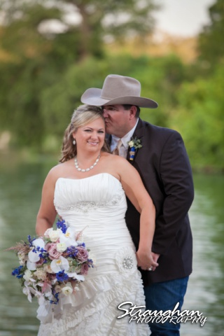 Angie wedding Marriott New Braunfels couple kissing