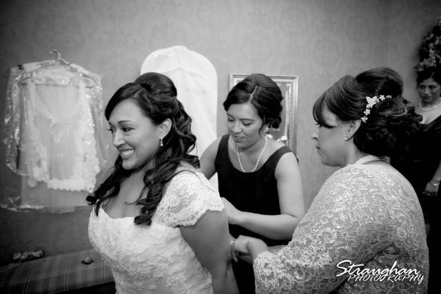 Anna wedding riverwalk San Antonio zipping the dress