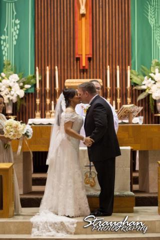 Anna wedding riverwalk San Antonio kiss