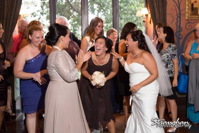 Anna wedding riverwalk San Antonio bouquet laughing