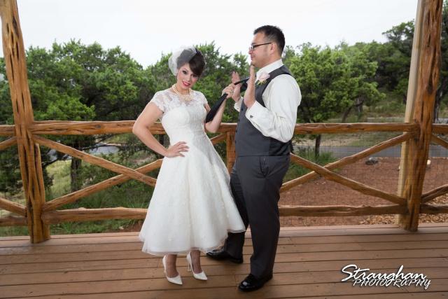 Agustina wedding Scenic Springs pulling grooms tie