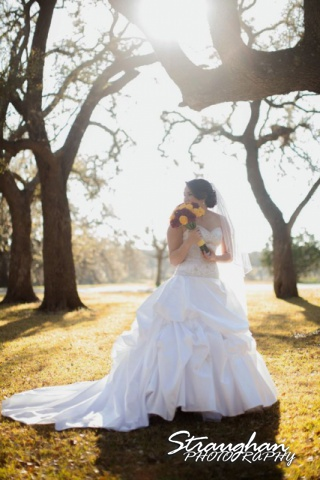 Allison's bridal Castle Avalon under the tree looking away
