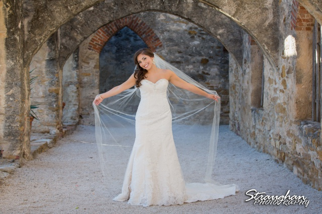 Allison H bridal Mission San Jose holding veil out