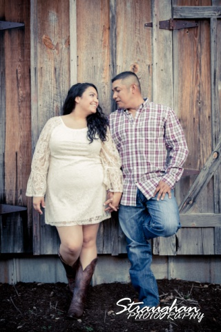 Alex and Johnny's engagement on the wooden wall