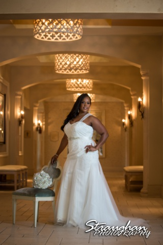 Allie's Bridal Hotel Eilan in the lobby standing by chair