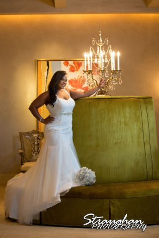 Allie's Bridal Hotel Eilan green couch with chandelier