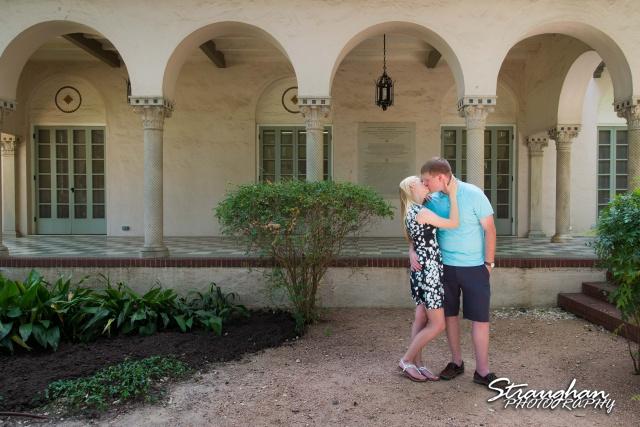 Nate engagement Landa Library kissing outside arch