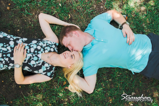 Nate engagement Landa Library laying in grass