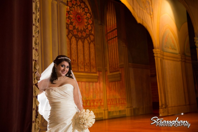 Allison bridal at Scottish Rite Theater San Antonio by curtain