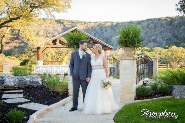 Pat wedding Bella Springs couple at bridge