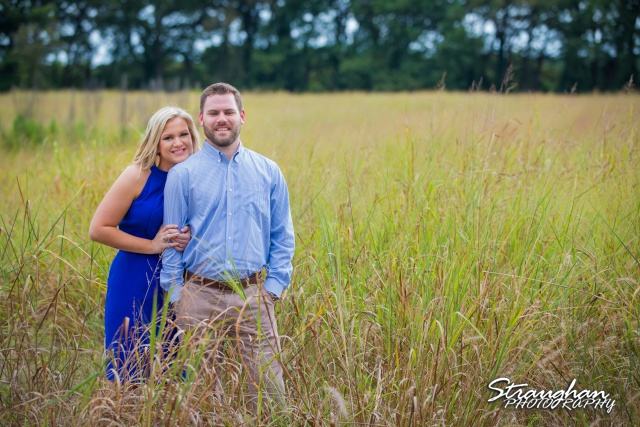Amanda and Pat engagement Cibolo Natural area in field
