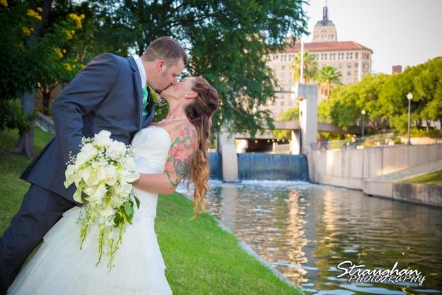 Sheehan wedding Inn on the riverwalk kiss over the river