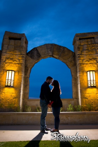 Allie and Ryan's engagement La Cantera arch kiss