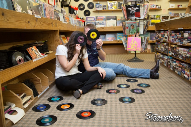 Allison engagement at the bookstore with the records