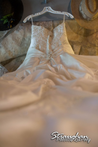Amanda Red Coral Ranch wedding dress on bed