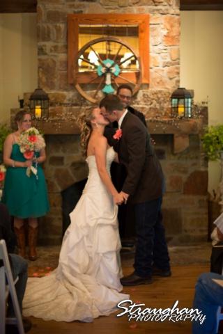 Amanda Red Coral Ranch wedding kiss