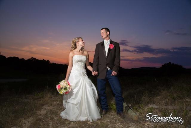 Amanda red coral ranch wedding couple at sunset
