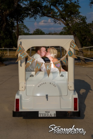 Brianna wedding Scenic Loop Cafe golf cart kiss
