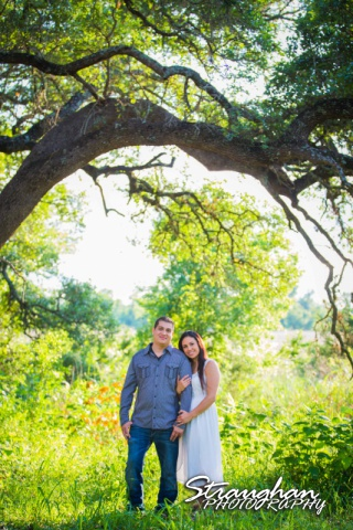 Britny and Dan's family style engagement under the tree