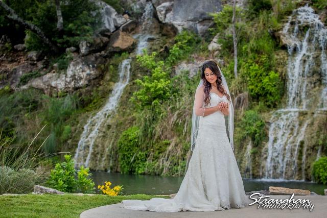 Britny's Bridal the lodge at bridal veil falls coy close up by falls