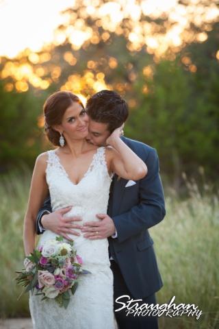 Clarissa wedding Vista West Ranch chris kissing clarissa neck