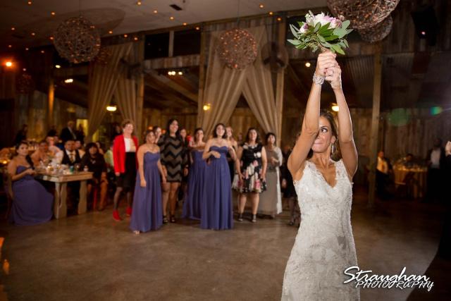 Clarissa wedding Vista West Ranch bouquet toss