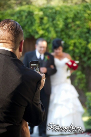 Cell phone in front of bride