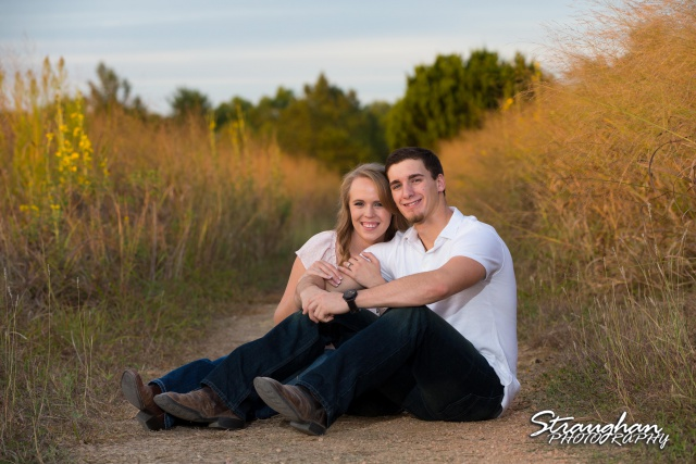 Caitlin engagement Cibolo Natural Area sitting on the path