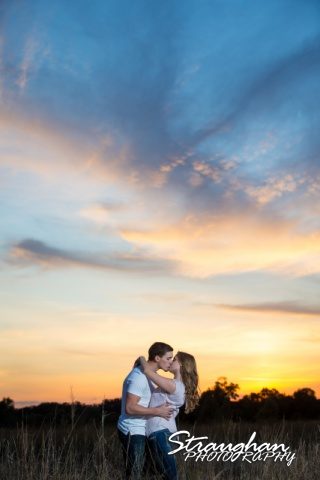 Caitlin engagement Cibolo Natural Area kiss with the sky