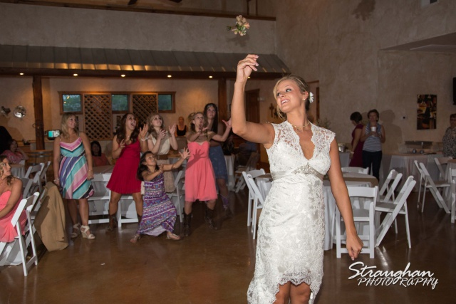 The vineyard at Gruene chelsey wedding bouquet toss