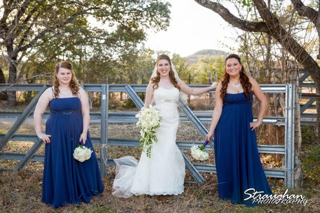 Cody Wedding Los Encinos bridesmaids on fence