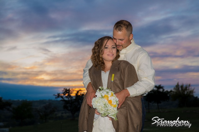 Samantha wedding Happy H Ranch coat over her sunset