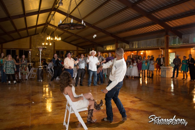 Samantha wedding Happy H Ranch garter toss