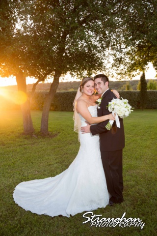 Erin Wedding Gardens of Cranesbury View the couple at sunset