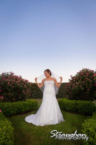 Erin Wedding Gardens of Cranesbury View bride in bushes