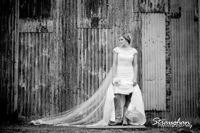 Emily's Bridal in Gruene bw against tin wall